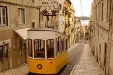 Tram navigating old street in Lisbon