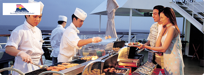 Chefs serving guests in the ship