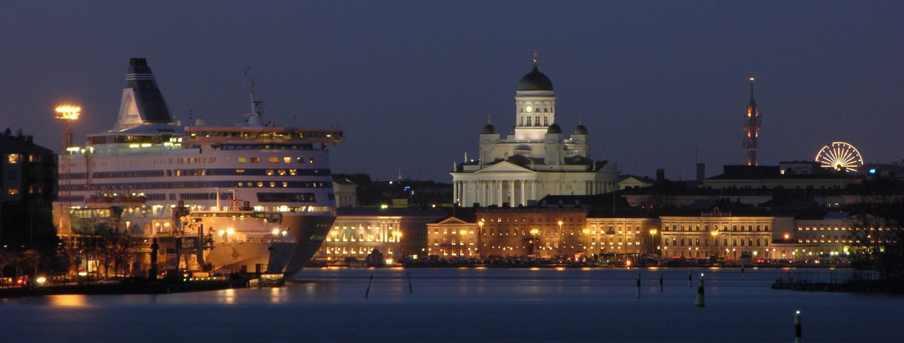 cruise ship docked in Helsinki harbour at night